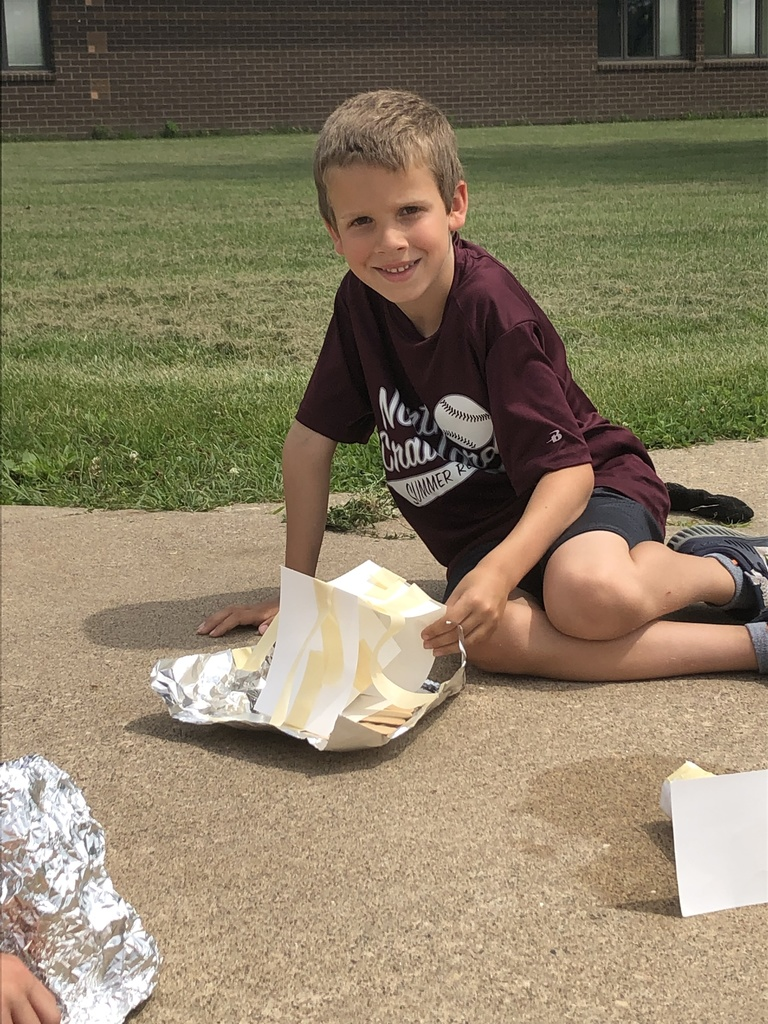 Picture Perfect STEM - building shade to prevent ice cube from melting in the sun during our Summer School Program.