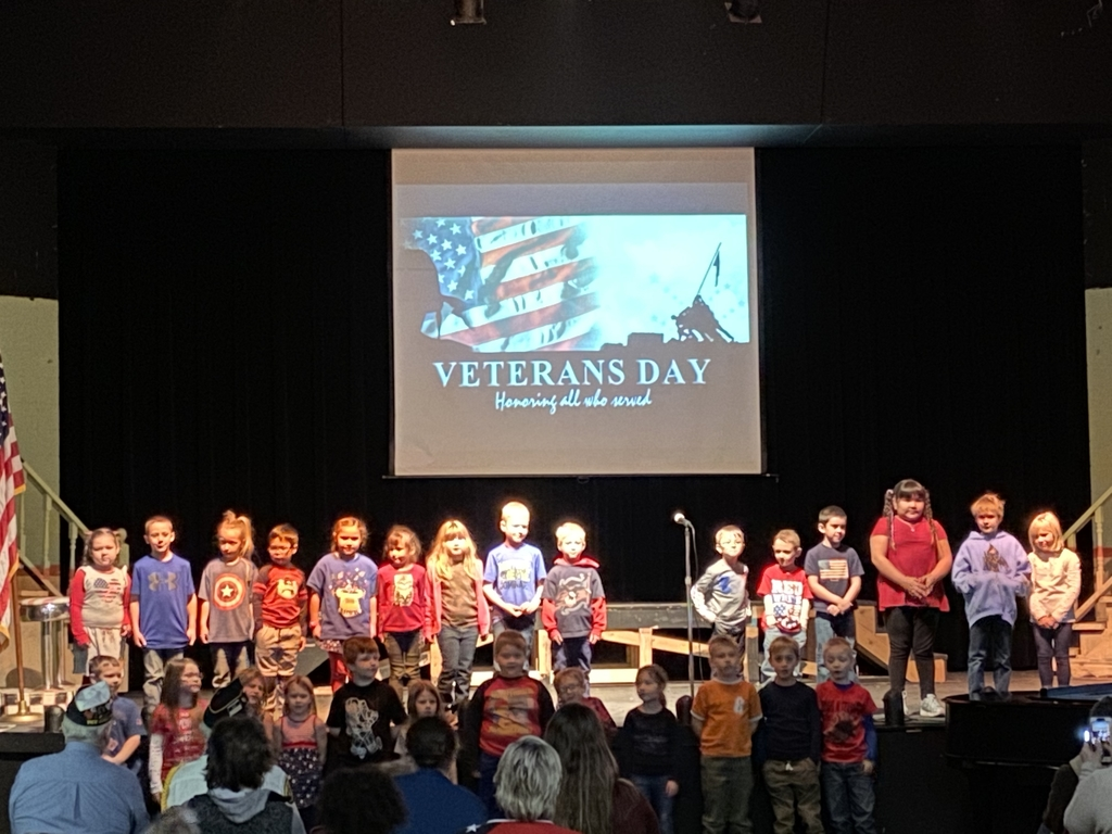 1st grade students singing patriotic songs